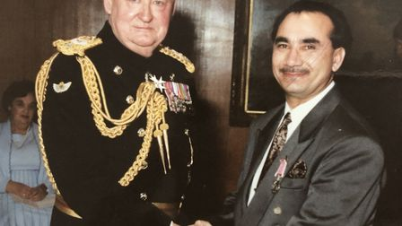 Mr Sheikh receiving his British Empire Medal in 1990. Picture: Sheikh family