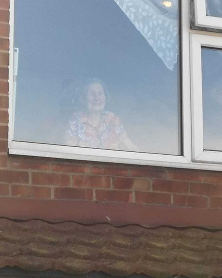 Jean Buniak looks out of her window at Birchwood Care Home, Clayhall. Picture: Helen Buniak