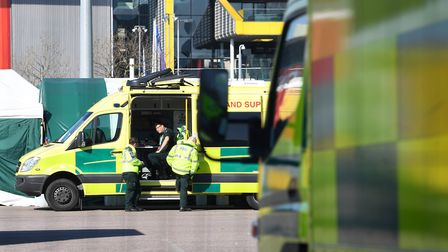 An ambulance crew await the first patients at the ExCel centre in London which is being made into th