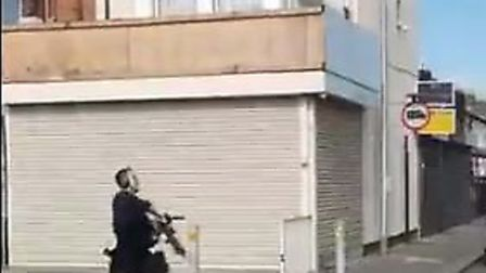 Three men were arrested on suspicion of possession of a firearm - an armed officer was seen chasing