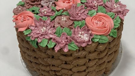 Healthcare play specialist Hamera Elahi recently baked this basket of flowers cake for her team in t