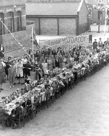 Neighbours celebrate VE Day in Dudley Road, Ilford, in 1945. Picture: Redbridge Museum & Heritage Ce