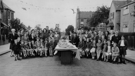 Then aged six, Mrs Cotton (third from right, front row) at VE Day celebrations in Birkbeck Road, New