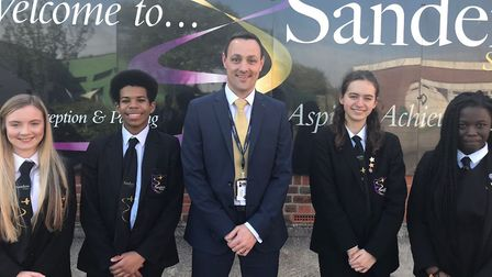 Sanders School's headteacher who joined in 2018, Stuart Brooks, centre, with student presidents Soph