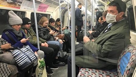 A man on the Underground wearing a protective facemask. Picture: PA