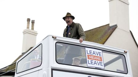 Nigel Farage looks down from the top deck of an open top bus during his visit to The Ship public hou
