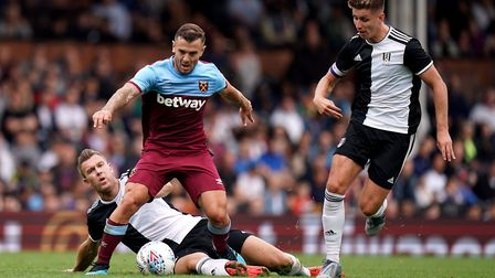 Fulham's Kevin McDonald (left) and West Ham United's Jack Wilshere battle for the ball during the pr