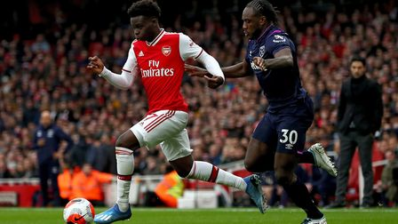 Arsenal's Bukayo Saka and West Ham United's Michail Antonio during the Premier League match at the E