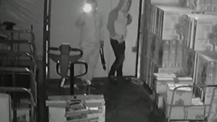 CCTV footage released shows the pair ignoring other stock while looking for the box of saffron. Pict