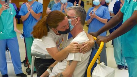 Steve and Gemma hug as he is clapped out of Queen's Hospital, Romford on Wednesday June 17. Picture: