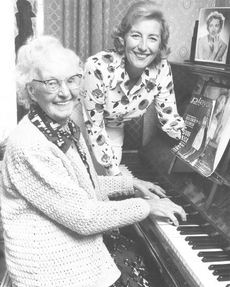 Dame Vera Lynn and her mother Annie Welch celebrate the singer's being made a dame in 1975 at Annie'