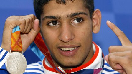 Great Britain's Amir Khan with his silver medal after losing to Cuba's Mario Kindelan in the lightwe