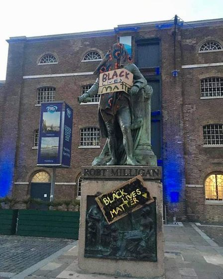 Black Lives Matter posters on the statue of slave owner Robert Milligan whose statue was remove from