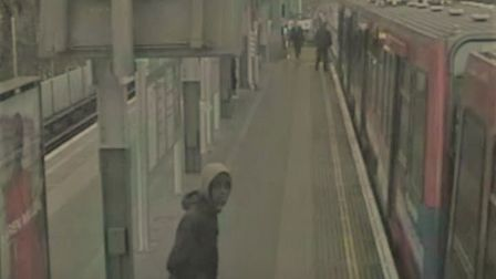 An image taken from the CCTV at Shadwell DLR station, which shows the suspect wanted in connection w