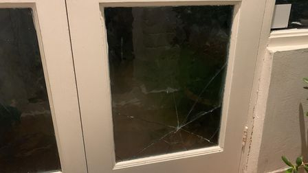 The living room window was also damaged. Picture: Rama Muraleetharan