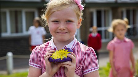 Amber Mron, five with her pebble at The James Oglethorpe Primary School where pupils decorated pebbl