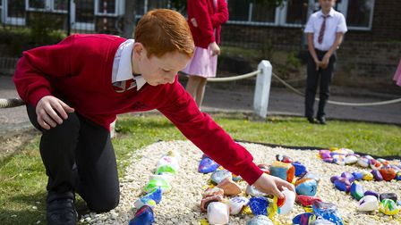 Tom Knowles, 11 with his pebble at The James Oglethorpe Primary School where pupils decorated pebble