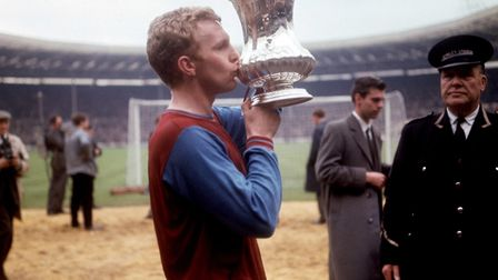 West Ham United captain Bobby Moore kisses the FA Cup in celebration after his team's 3-2 victory