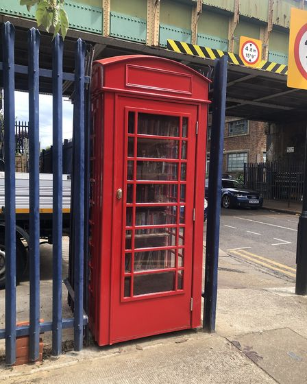 Niamh's dad, Kieran, built the phone box using leftover wood. Picture: Niamh Connole