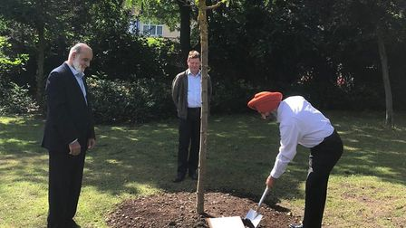 Redbridge Council leader Jas Athwal plants a tree in Valentines Park to honour the victims of the Sr