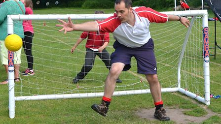 Headteacher Matthew Jordan in goal for the penalty shoot-out at the Gunton Primary Academy fete. Pic