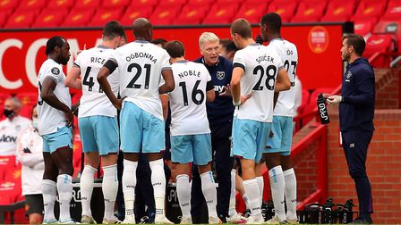 West Ham United manager David Moyes speaks to his players during the first half drinks break at Old