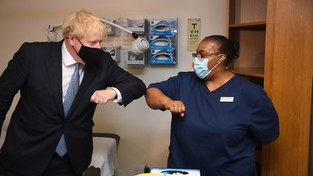 Mr Johnson elbow bumps lead nurse Marina Marquis during the visit. Picture: Evening Standard/Jeremy
