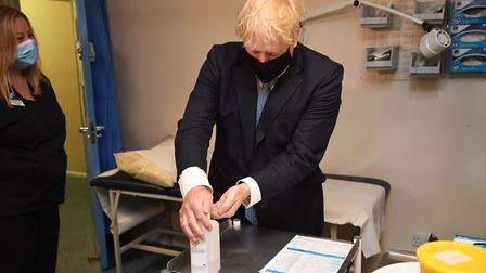 The prime minister uses hand gel during his visit. Picture: Evening Standard/Jeremy Selwyn/PA Wire