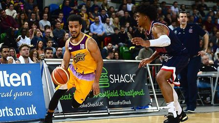 London Lions Justin Robinson races clear with the ball against Bristol Flyers (Pic: Graham Hodges)