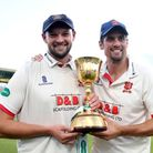 Essex's Nick Browne and Alastair Cook celebrate with the County Championship trophy at Taunton
