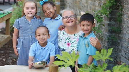 Gael Hicks with pupils in the Key Stage 1 garden. Picture: St Helen's Catholic Primary School