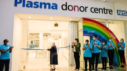 The UK's first Covid-19 convalescent plasma recipient Ann Kitchen cuts the ribbon at the new donor c
