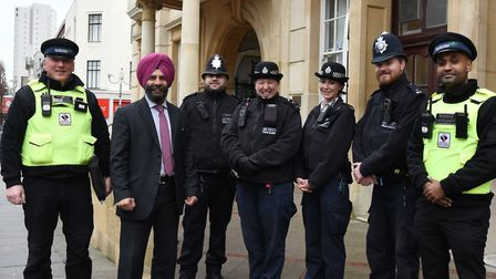 The Leader of Redbridge council Jas Athwal, pictured with some of the borough's police officers, say