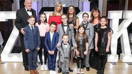 Hazel pictured alongside family members, including her grandchildren. After a lengthy period in the