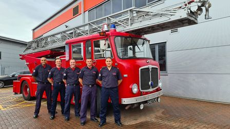 Serving officers from Harold Wood fire station pictured beside the vintage fire engine. L-R: Firefig