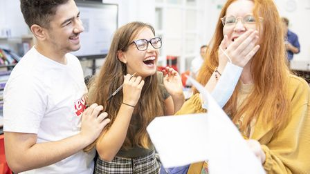 East London Science School pupils Ahmet Oguz, Lilly Savy-Gorman and Martha Hinde delighted on receiv