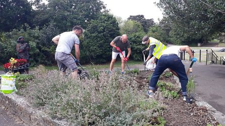 The gardeners at work on the flower bed. Picture: Loxford Gardeners