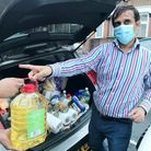 Junaid Ali and a team of volunteers have been delivering grocery packs to the front doors of people