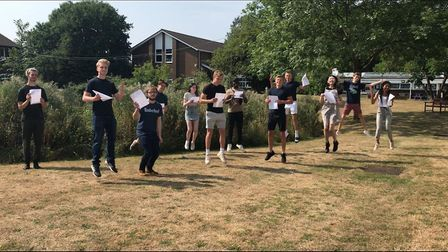 Students jump for joy after receiving their A-level results at The Coopers' Company and Coborn Schoo