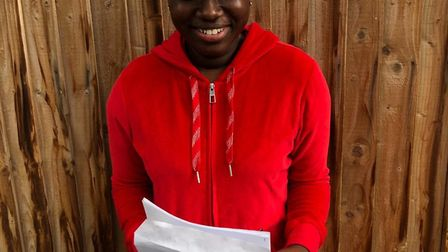 "Fanta Kebe was ""delighted"" with her results, which included eight 9s. Picture: Oasis Community Learn"