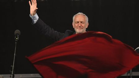 A red flag flies as Labour leader Jeremy Corbyn speaks at a rally at Pier Head in Liverpool, ahead o