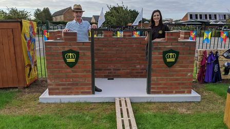 Isabella Martin and her father Jose with the castle they built in the nursery garden at Crownfield I