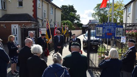 People gathered outside the Elm Park Royal British Legion for a short ceremony in which a wreath was