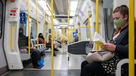 Commuters wearing face masks on the London Underground. Picture: Eleanor Bentall