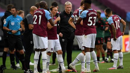 West Ham United manager David Moyes speaks to players during the drinks break