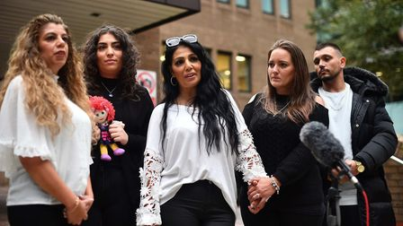 Relatives of Mary Jane Mustafa, including cousin Ayse Hussein, left, and sister Mel Mustafa, centre,