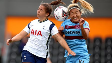 West Ham United's Cho So-hyun (right) and Tottenham Hotspur's Kit Graham battle for a header during