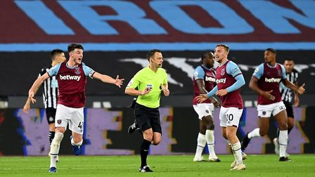 West Ham United's Declan Rice chases referee Stuart Attwell as he appeals for a hand ball during the