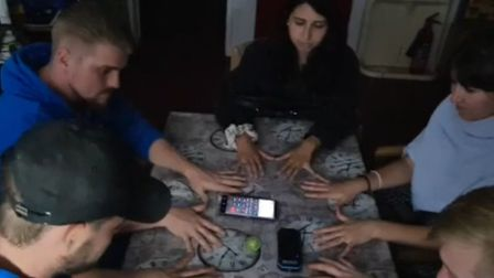 A shot from Paranormal Essex's stream with the Recorder reporters to conduct a sceance in Breton's M