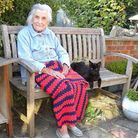 Cat enthusiast Phyllis pictured in the garden alongside family pets Blackie and Pushkin. Blackie die